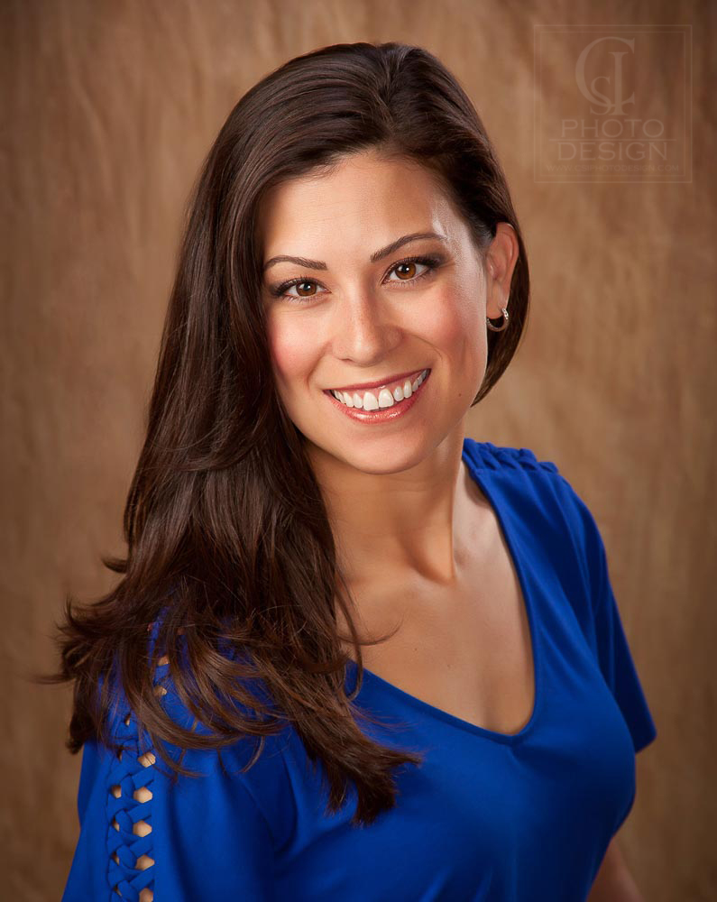Business woman in a blue top on a brown background