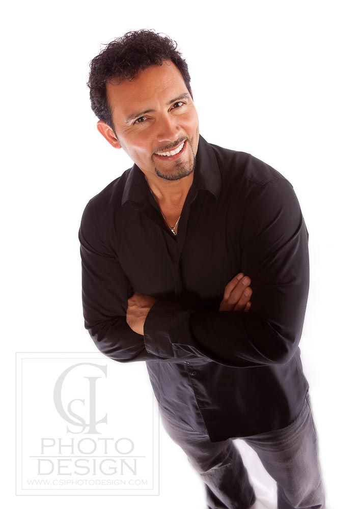 Business man in a black shirt on a white background looking down