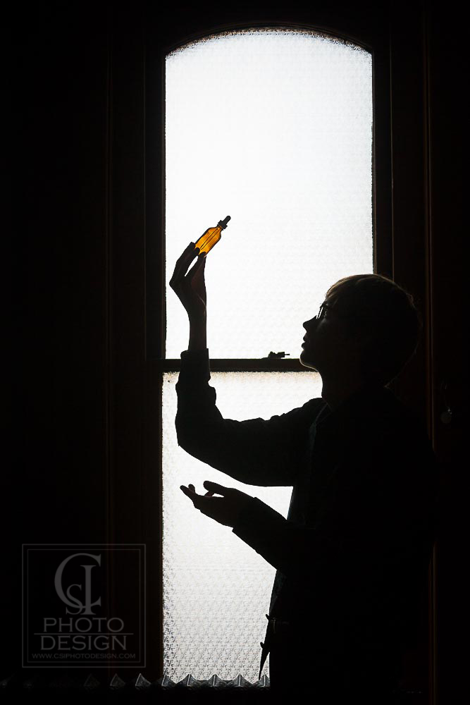 Senior boy silhouette with bottle