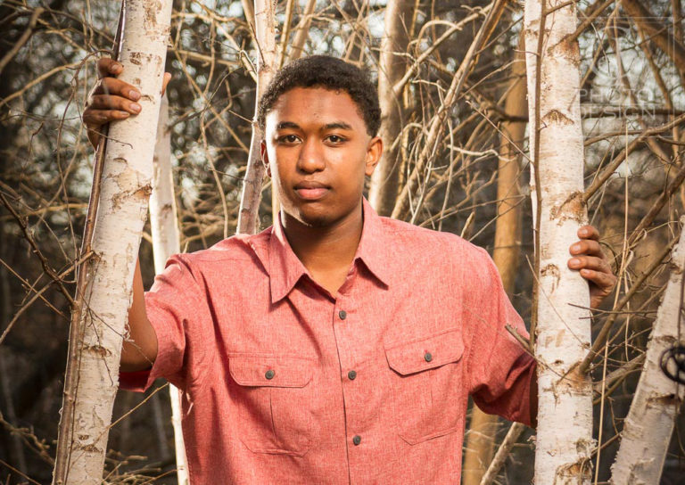 Senior boy standing in Aspens