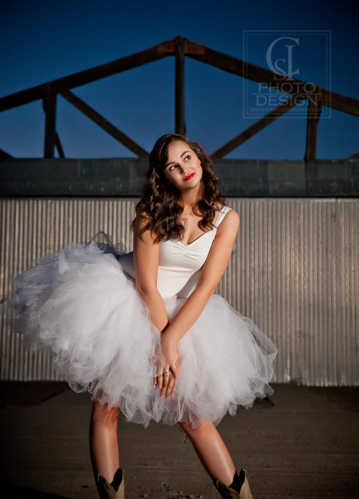 Senior girl in tutu and cowboy boots