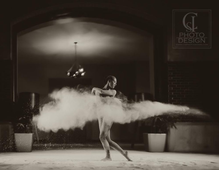 Senior girl dancing in a ballroom throwing flour