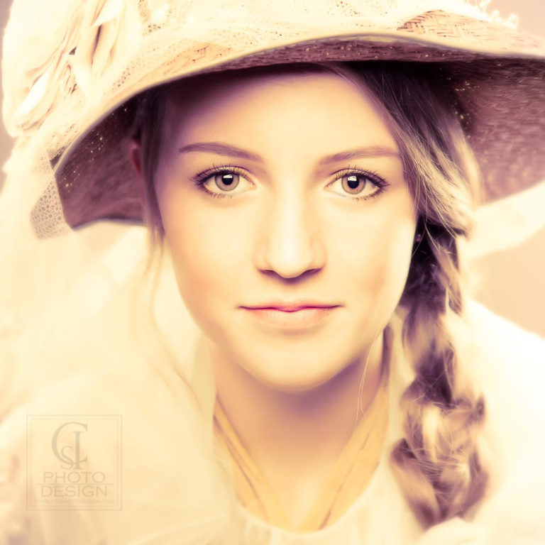 Senior girl close up with straw hat and braided pony tail