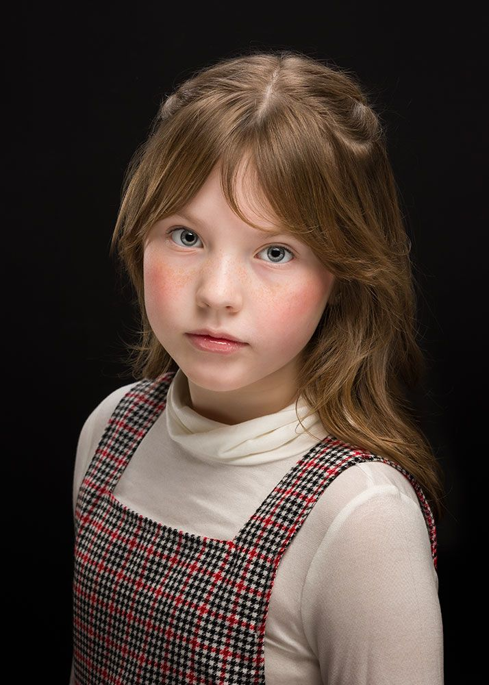Kid actor on black background